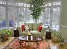 Home interior. Interior of a corner room with tall windows and a view outside Royalty Free Stock Photography