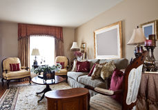 Home Interior. Well-decorated living area of a model home stock photo