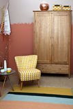 Home interior. With an armchair and cupboard Royalty Free Stock Image