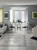 Home interior with bow window. Light colors home interior with bright bay window royalty free stock images