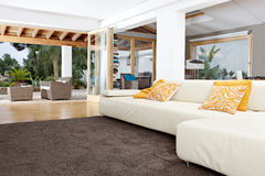 Home Interior with Carpet. Interior of a well designed home's living room with garden views and carpets Stock Photo