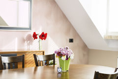 Home interior with chrysanthemums flowers in green glass vase Stock Photo