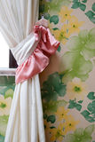 Home Interior - Curtains With Flower Wallpaper. In home stock photo