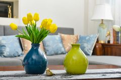 Home interior decor, tulip bouquet in vase. Home interior decor,tulip bouquet in a vase on wooden table runner, in living room Stock Image