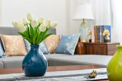 Home interior decor, tulip bouquet in vase. Home interior decor,tulip bouquet in a vase on wooden table runner, in living room stock images