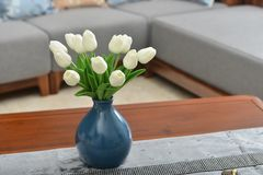 Home interior decor, tulip bouquet in vase. Home interior decor,tulip bouquet in a vase on wooden table runner, in living room Stock Photos