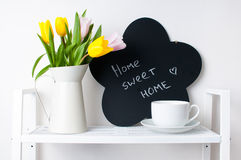 Home Interior Decoration: A Bouquet Of Tulips, A Cup And A Chal Royalty Free Stock Images