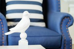 Home interior decoration with american Newport style, living room have a blue sofa and Striped pillow with white bird royalty free stock photo