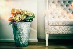 Home interior decoration with flowers floor vase and white couch Royalty Free Stock Images