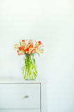 Home interior design with bunch of tulips and vase. Springtime Stock Photo