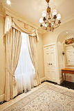 Home interior: Drapery. Luxurious window coverings of a home interior stock photography