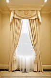 Home interior: Drapery. Luxurious window coverings of a home interior royalty free stock photo