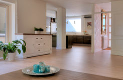 Home interior. Empty living room in soft colors with view to the kitchen and hall royalty free stock photos