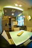 Home Interior Fisheye View. Fisheye view of a modern home interior, including kitchen and dining area royalty free stock photos