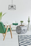 Home interior with green chair Stock Photo