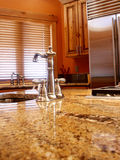 Home Interior Kitchen. Kitchen area with stainless appliances,plumbing fixtures and granite counter tops Royalty Free Stock Photography