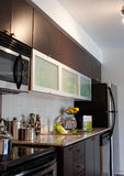 Home Interior: Kitchen. Side view of a model home kitchen stock photography
