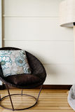 Home interior, large round cane chair Royalty Free Stock Photos