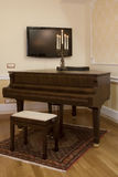 Home interior with piano. And candle Royalty Free Stock Image