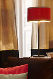 Home interior with red lamp and window with curtains Royalty Free Stock Photo