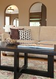 Home in interior sofa and coffee table details. Stock Images