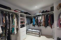 Walk in wardrobe. Home interior spacious walk in wardrobe royalty free stock photos
