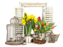 Home interior with spring flowers, easter eggs stock images