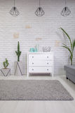 Home interior with white dresser. And grey rug royalty free stock images