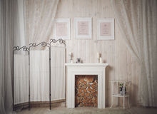 Home interior with white fireplace, pictures and candles Stock Image