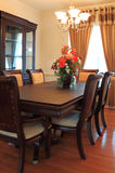 Home Interiors. With dining table, chair, cabinet, chandelier and hardwood floor Stock Photos