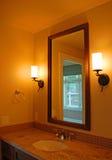 Home Interiors. Warm Colored Condo Bathroom Interior Vanity Royalty Free Stock Photo