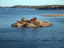 Home on isle. Travel by ferry on Finnish Sea Royalty Free Stock Image
