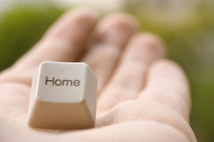 Home key. On palm of the hand Stock Photo