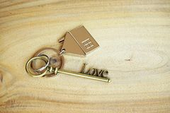 Home key with house keyring on wood background. Free space Royalty Free Stock Photos
