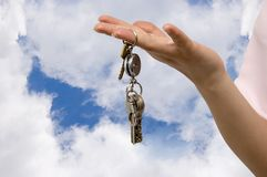 Home keys. Woman hold in hand a bunch of keys Royalty Free Stock Photo