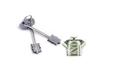 Home keys & dollar. Home keys and 1 dollar like tshirt as symbol of success royalty free stock photos