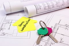 Home keys, house of yellow paper with text home construction and diagrams Royalty Free Stock Photos