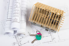 Home keys, small house under construction and electrical drawings, building home concept Stock Photography