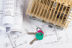 Home keys, small house under construction and electrical drawings, building home concept Stock Image