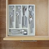 Clean silverware utensils in kitchen drawer. Neat, tidy, organized home kitchen storage. Home kitchen cabinets storage organization. Clean silverware utensils in royalty free stock image