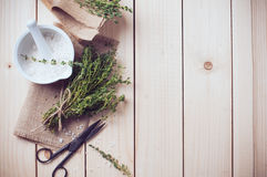 Home kitchen still life. Cozy rustic home kitchen still life, dried herbs thyme, salt in white mortar, old wooden box and vintage scissors on a table background Royalty Free Stock Photos