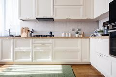 New home kitchen with white wooden furniture. Home kitchen with white wooden furniture Stock Photo