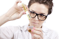 Home laboratory. Young student preparing home made cosmetics Stock Photography