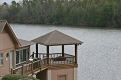 Home On Lake. Water front deck of home on lake. Relaxing gazebo like area Stock Photo