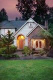 Home lampor på skymningen Fotografering för Bildbyråer