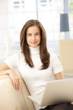 home laptop smiling woman Стоковая Фотография