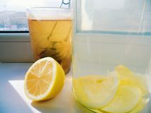 Home lemonade with lemon and a cup of tea.  Stock Photography