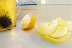 Home lemonade with lemon and a cup of tea.  Stock Images