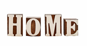 Home letters. Isolated over white, rough wooden blocks spelling the word home (intentionally grungy stock illustration