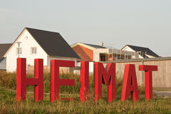 Home Letters in front of Houses Stock Images